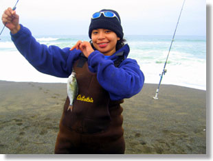 Angler shows off her silver surfperch, CDFW photo by Adrienne Vincent